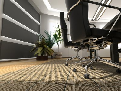 close-up on Auckland office carpeting underneath office chair wheels with sun shining through blinds